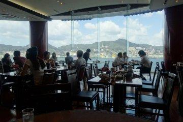 <p>The sweeping views of Nagasaki Bay from the dining room of Shikairo</p>