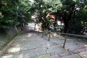 Long stone steps leading to the entrance of Fujishima Shrine on the hillside of Mount Asuwa