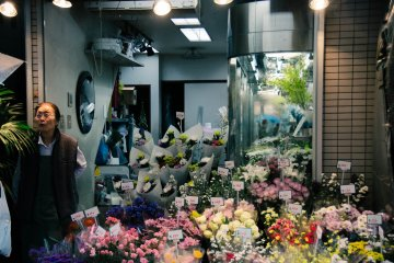 <p>Florist and her flower shop.</p>