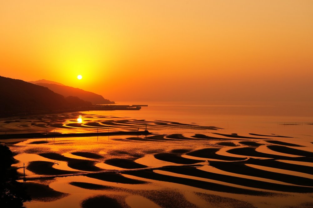 I dreamed of coming to see this sunset view of the mud flats on Okoshiki Beach