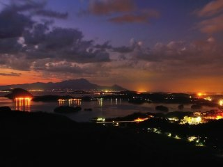 The sunset view from Mount Sengan, with Kami Amakusa city at the bottom right, and Shimabara Peninsula on the far left