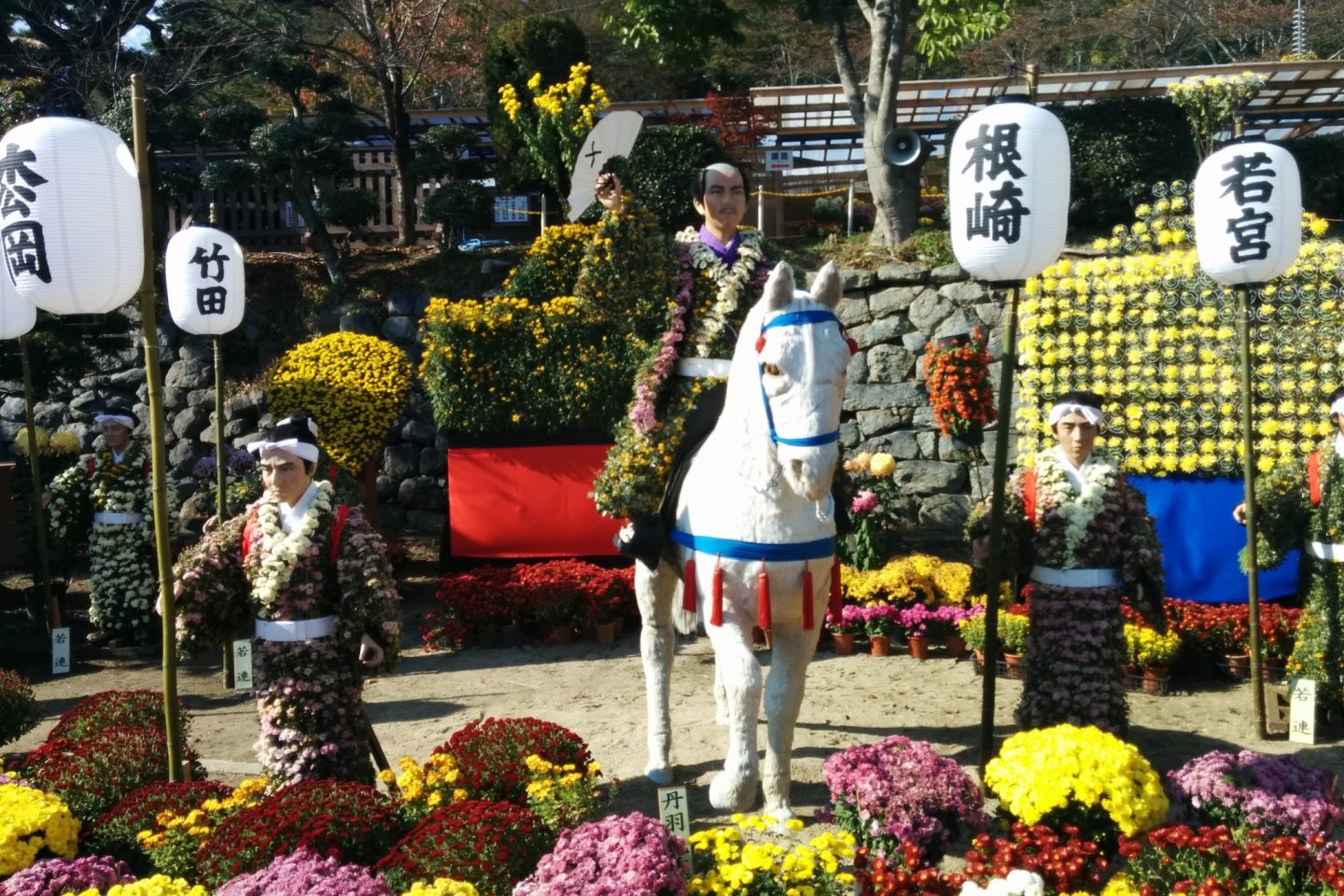 One of the highlights of the festival is this scene of flower dolls and potted flowers along the water