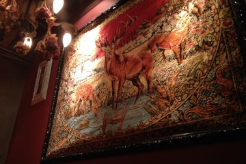 <p>Tapestries decorate the walls</p>