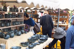 Stalls selling all styles of pottery offer heavily discounted pottery during the fair