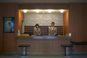<p>The hotel manager, Toshiro Nagahama, and his lovely front desk colleague&nbsp;</p>
