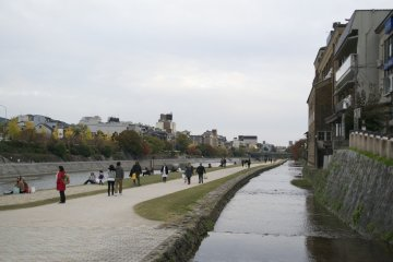 <p>The cloudy weather didn&#39;t stop people from walking along Kamogawa</p>