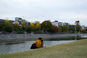 <p>A couple chilling at the riverbank</p>
