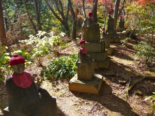 These little red capped statues run along the hiking path within and between the trees.  They impart a sense of watchfulness and protection