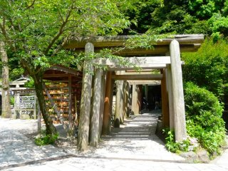 These series of wooden torii gates on the other end of a tunnel carved into the hill mark the entrance to the Zeniarai Benzaiten Temple.