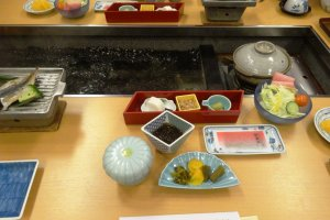 A shot of part of breakfast - the middle of the table is filled with hot spring water used to boil your breakfast eggs