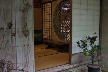 <p>A peek inside the left open shoji paper door towards the interior</p>