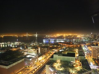 Night view from 'see through' gondola - photo taken during the ride. Yokohama Bay Bridge in the distance