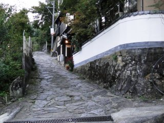 You can follow the pavement at least a kilometer up to the top of town