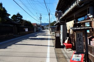 A look down the old Tokaido Highway with the 180 year old Izumiya in the foreground.