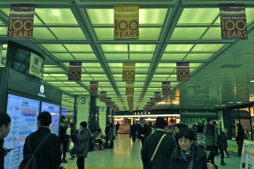 <p>Commuters passing through Tokyo Station during the 100th Anniversary celebration</p>
