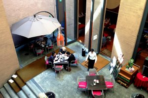 The Modern High Atrium Space at Cafe Cube is a pleasant place to rest in the summer heat