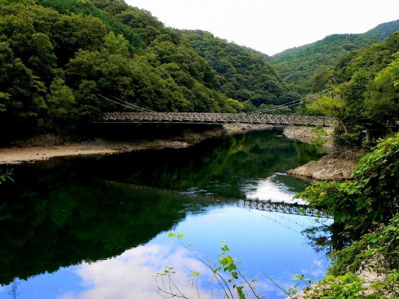 <p>Hanging bridge above beautiful reflections</p>