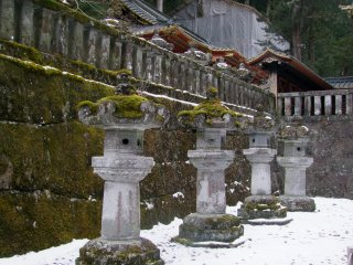 Stone lanterns looking majestic in the snow