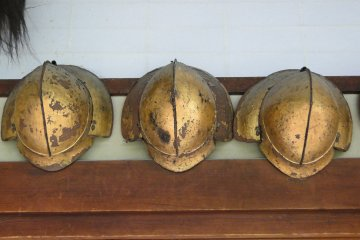 <p>Old helmets hanging in the estate&#39;s main hallway</p>