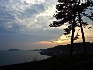 Sunset view with Enoshima from the top of Inamura-ga-saki Koen Park