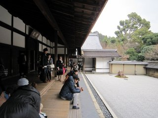 Tourists relaxing in front of the rock garden