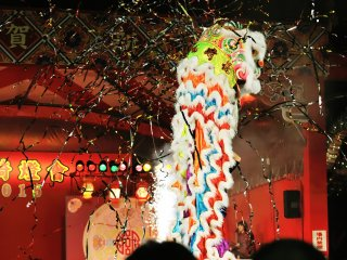 The lion dance climaxed with a loud bang!
