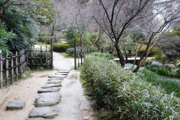 <p>A stone path leads around the rear of the property</p>