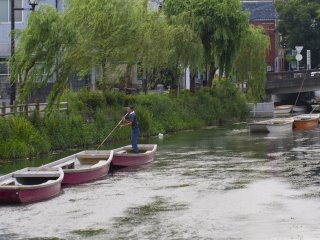 Each worker can collect and park a line of boats at the end of the day