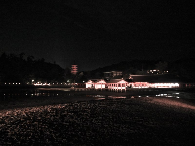 <p>Itsukushima Shrine from a distance, with Daisho-in Temple behind it on the hill</p>