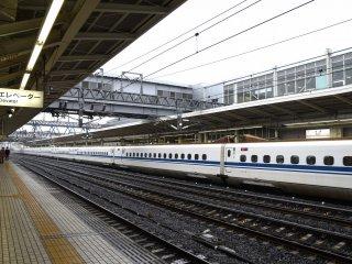 Long cars of the Shinkansen (bullet train) stopping at Maibara