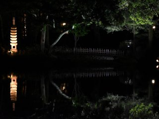 A stone lantern, bridge, trees...everything was reflected on a mirror-like pond surface!