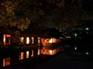 Illuminated Yokokan house in the dark