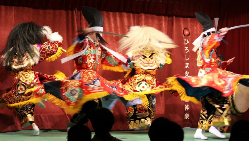 <p>Spinning quickly in unison with costumes flaring, one of the famous trademarks of Kagura</p>