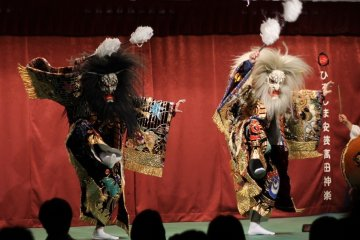 <p>These two demons were happily dancing in unison and hitting the stage occasionally with sticks</p>