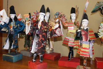 <p>Paper doll crafts on display</p>