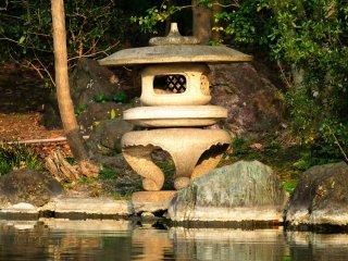 Stone lantern set on the edge of the pond