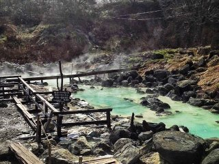 This sulphurous pool bubbles in the grounds of Kuroyu, but don't touch the water - it's scalding hot! Water is piped from the source to the different pools, cooling down to a bearable temperature along the way.
