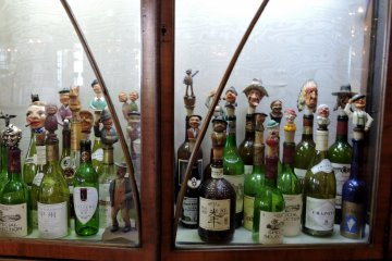 <p>Collection of humorous bottle stoppers</p>