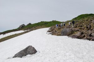 There is still snow on top of Mount Gassan in mid summer.
