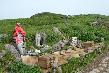 Buddha statues jizo statues on top of Mount Gassan