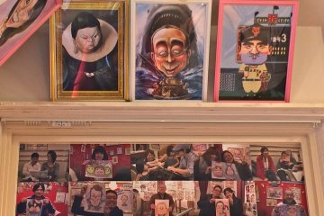 <p>A few caricatures of famous people from Japan and visitors with their portraits</p>