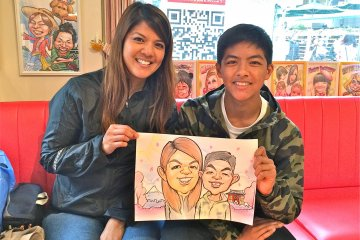<p>My son and I holding our finished caricature. What do you think?</p>