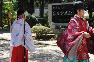 Priest and priestess come to collect the bride and groom for a traditional wedding