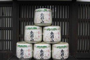 Large casks of Ena-san sake sit outside Hazama.
