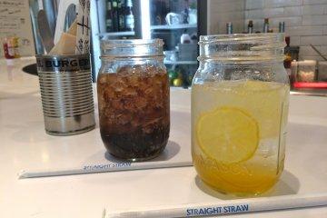 <p>Homemade Honey Lemonade and Coca-Cola served in mason jars</p>