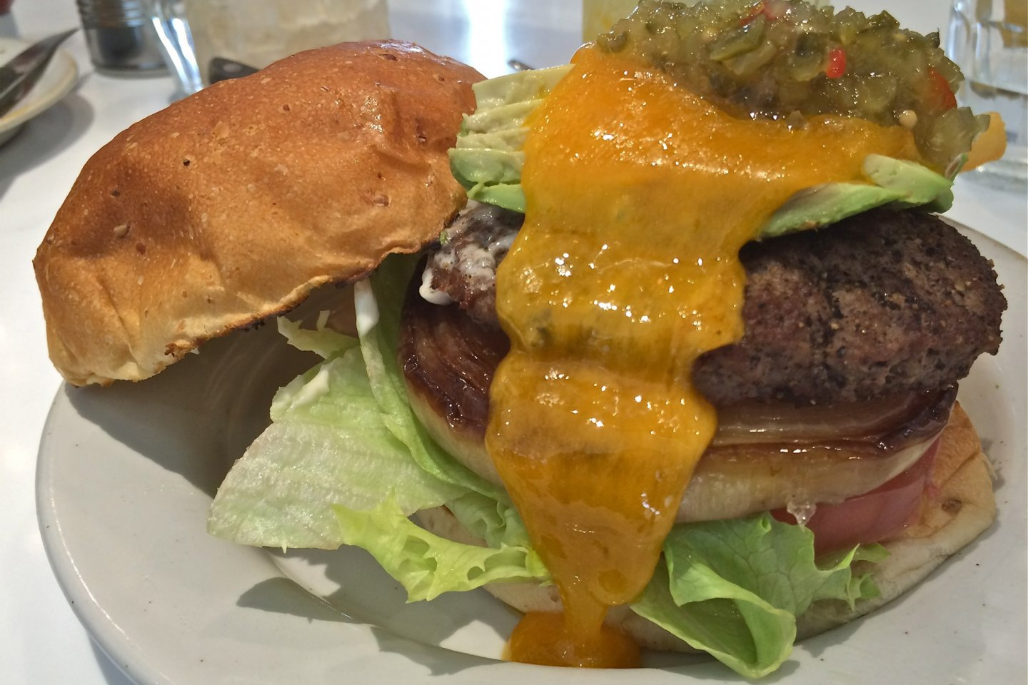 The J.S. Burger is topped with relish, cheddar cheese, lettuce, tomato, and grilled onion. Mmm mmm mmm!
