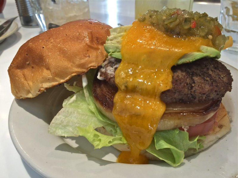 <p>The J.S. Burger is topped with relish, cheddar cheese, lettuce, tomato, and grilled onion. Mmm mmm mmm!</p>