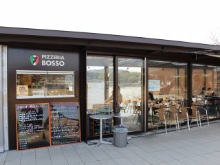 Outside Pizzeria Boso with the lake view in the background