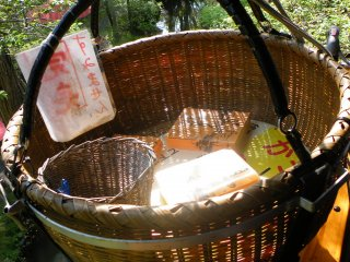 The last order for the day. To the left is the basket where you deposit your money for the dumplings.