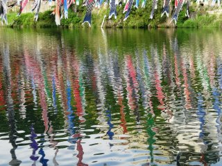 The streamers are reflected in the water